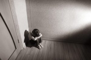 Abused child sat in the corner alone...